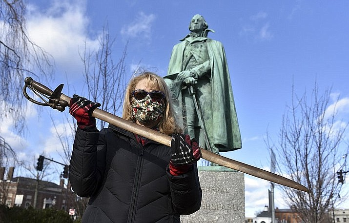 Cindy Gaylord, chairwoman of the Westfield Historical Commission, holds the original sword from the statue of Gen. William Shepard that stands near the town green in the center of Westfield, Mass., on Dec. 29, 2020. A veteran returned the sword he stole from the statue 40 years ago, telling Gaylord that he regretted taking it. (Don Treeger/The Republican via AP)