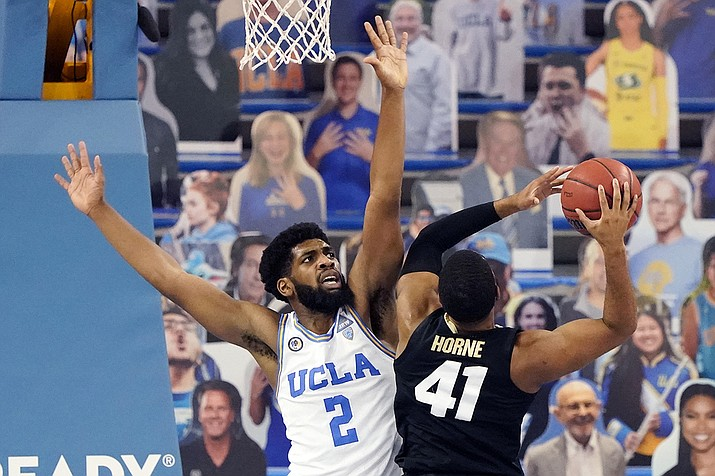 UCLA forward Cody Riley, left, defends on Colorado forward Jeriah Horne (41) during the second half of an NCAA college basketball game Saturday, Jan. 2, 2021, in Los Angeles. (Marcio Jose Sanchez/AP)