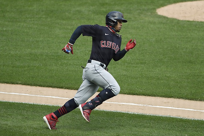 Cleveland Indians' Francisco Lindor runs after hitting a double against the Chicago White Sox during the fourth inning of a baseball game in Chicago, in this Saturday, Aug. 8, 2020, file photo. The Cleveland Indians have agreed to trade four-time All-Star shortstop Francisco Lindor and pitcher Carlos Carrasco to the New York Mets, a person with direct knowledge of the deal told the Associated Press on Thursday, Jan. 7, 2021.(Nam Y. Huh, AP File)