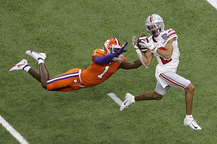 Ohio State wide receiver Chris Olave catches a touchdown pass in front of Clemson cornerback Derion Kendrick during the second half of the Sugar Bowl NCAA college football game Friday, Jan. 1, 2021, in New Orleans. (Butch Dill/AP)