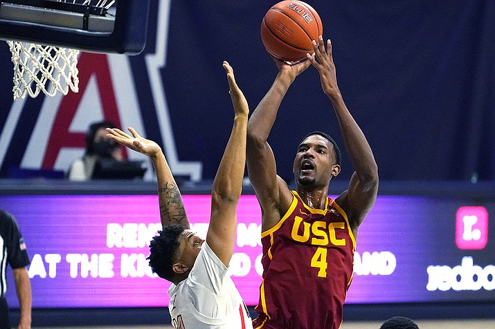 Southern California forward Evan Mobley (4) shoots over Arizona forward Ira Lee during the first half of an NCAA college basketball game Thursday, Jan. 7, 2021, in Tucson, Ariz. (Rick Scuteri/AP)