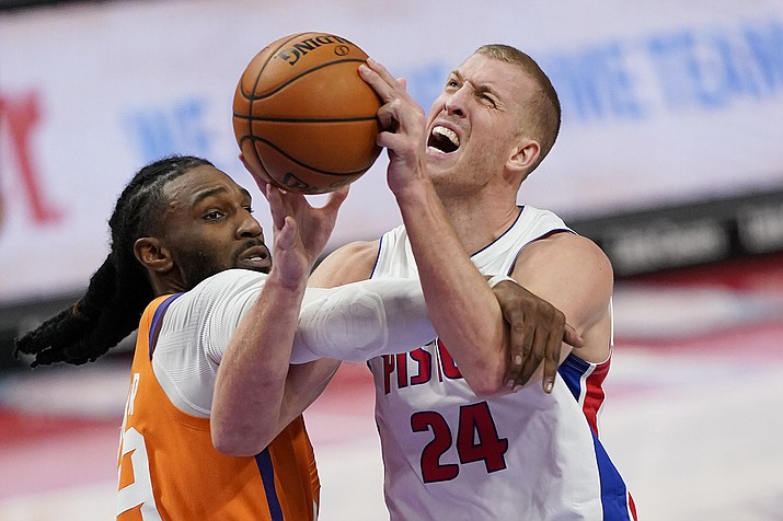 Detroit Pistons center Mason Plumlee (24) is fouled by Phoenix Suns forward Jae Crowder during the second half of an NBA basketball game, Friday, Jan. 8, 2021, in Detroit. (Carlos Osorio/AP)