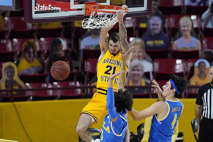 Arizona State forward Chris Osten (21) dunks over UCLA guards Johnny Juzang (3) and Jaime Jaquez Jr. (4) during the second half of an NCAA college basketball game Thursday, Jan. 7, 2021, in Tempe, Ariz. (Ross D. Franklin/AP)