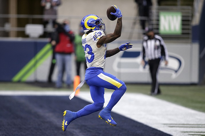 Los Angeles Rams running back Cam Akers reacts after scoring on a 5-yard run against the Seattle Seahawks during the first half of an NFL wild-card playoff football game, Saturday, Jan. 9, 2021, in Seattle. The Rams won 30-20. (Scott Eklund/AP)