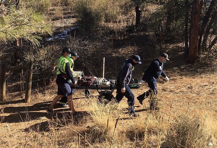 An 87-year-old hiker is rescued by Prescott Fire Department crew members after he ran out of water and passed out while hiking near Lynx Lake on Thursday, Jan. 7, 2021, in Prescott. (Prescott Fire Department/Courtesy)