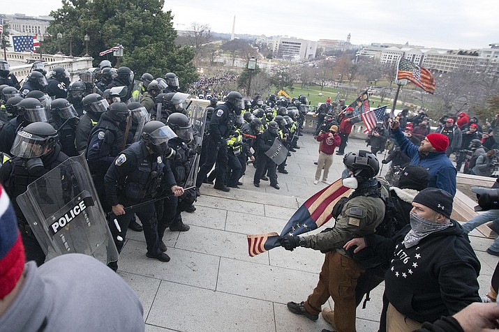 U.S. Capitol Police push back demonstrators who were trying to enter the U.S. Capitol on Wednesday, Jan. 6, 2021, in Washington. (AP Photo/Jose Luis Magana)