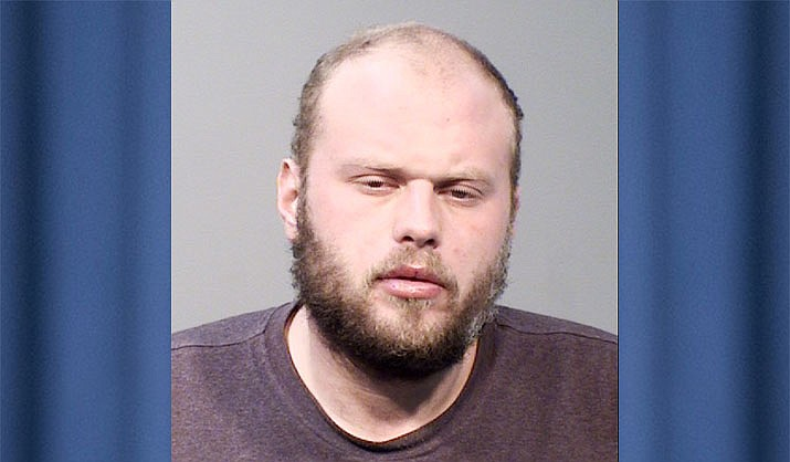Robert Dix, 26, was arrested after he allegedly robbed a Prescott Valley man of $600 at a local ATM by using his hand in his jacket pocket to simulate a gun. (PVPD/Courtesy)