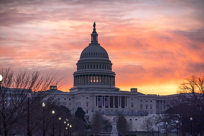 Dawn breaks at the Capitol in Washington Jan. 11. On Jan. 6, the U.S. Capitol building was overrun by rioters during a Save America Rally. (AP Photo/J. Scott Applewhite)