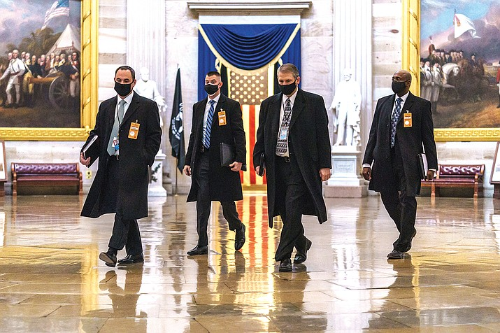 Security officials survey the Capitol in Washington, Jan. 11, ahead of the scheduled presidential inauguration. (AP Photo/J. Scott Applewhite)