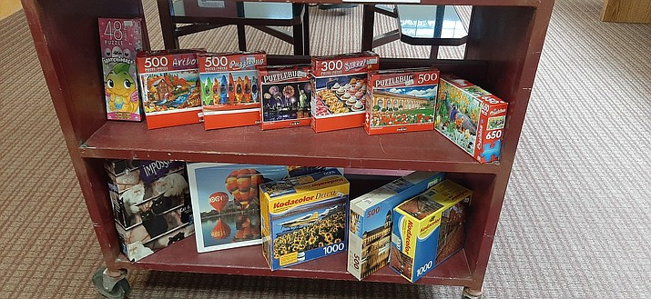 Puzzles, among other items including books for all ages and blue-ray/DVD movies, are available both for purchase or check out at Chino Valley Public Library (1020 W Palomino Rd). To request one, knock on the front door for curbside service, or call 928-636-2687. (Town of Chino Valley/Facebook, Courtesy)