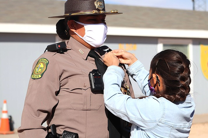 A graduate of the Navajo Police Training Academy is pinned during a ceremony Jan. 2 in Chinle, Arizona. (Photo/Navajo Nation Police Dept.)