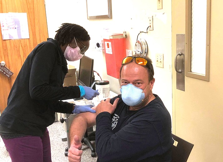Tusayan Fire Chief Greg Brush receives the vaccination Jan. 7 at the Grand Canyon Clinic. (Photo/ Tusayan Fire District)
