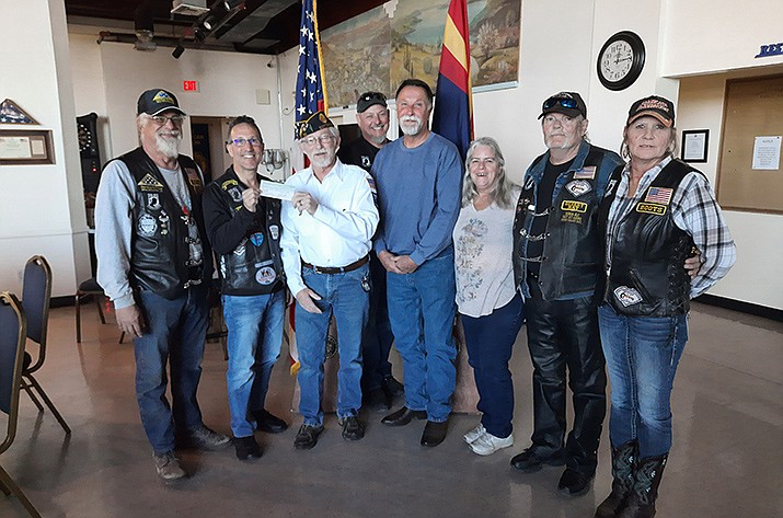 Saturday, officers and other members of the Modified Motorcycle Association of Arizona, Verde Valley District, present a check for $3,287 to American Legion Post 25. From left: Arye Algazy, treasurer David Goldstein, Legion Post Commander Bill Tinnin, Allen Olesen, assistant district manager Gary Windharm, secretary Patty Eames, sergeant-at-arms Harley Kipena and Karen Beebe. VVN/Jason W. Brooks