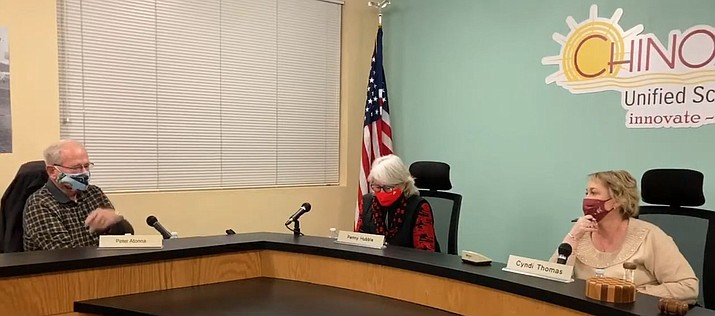 During a Chino Valley Unified School District governing board meeting on Monday, Jan. 11, 2021, board member Peter Atonna, left, board vice president Penny Hubble, middle, and board president Cyndi Thomas discuss whether or not schools should reopen on Jan. 19 despite a rising number of coronavirus cases in Yavapai County. (Screenshot)