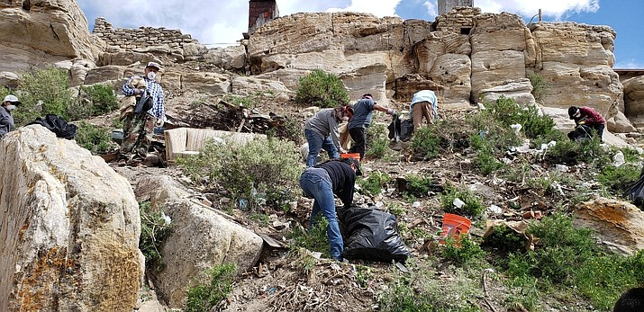 First Mesa Community members clean-up trash on the north side of the mesa below Tewa Village. First Mesa Annual Clean-up has been selected for a grant to aid in clean-up efforts. (Photo/Hannah McElgunn)
