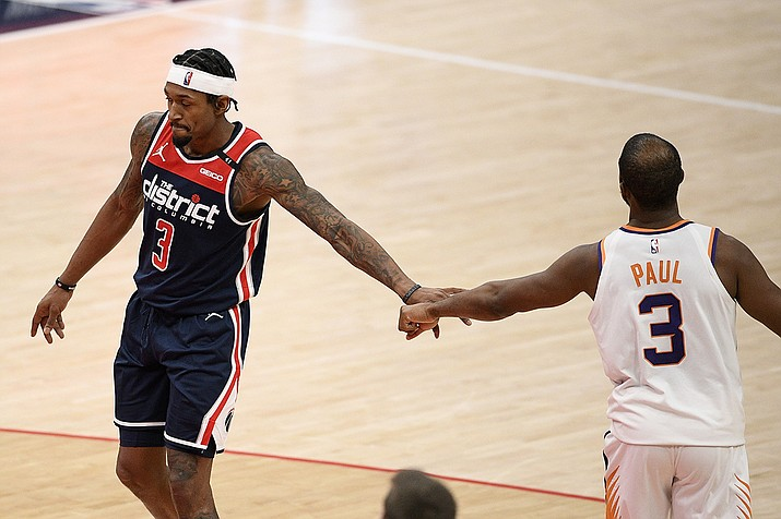 Washington Wizards guard Bradley Beal, left, and Phoenix Suns guard Chris Paul, right, tap hands during the second half of an NBA basketball game, Monday, Jan. 11, 2021, in Washington. ( Nick Wass/AP)