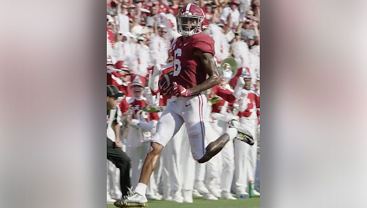 Heisman Trophy winner DeVonta Smith of the University of Alabama capped his college football career with 12 catches, including three touchdowns, in the first half of the national championship game on Monday, Jan. 11. Alabama beat O)hio State 52-34. (Photo by The University of Alabama, cc-by-sa-3.0, https://bit.ly/38zYQWo)