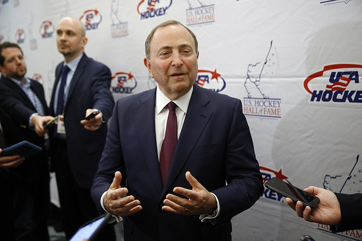 NHL Commissioner Gary Bettman speaks with members of the media before being inducted into the U.S. Hockey Hall of Fame in Washington, in this Thursday, Dec. 12, 2019, file photo. Like the NBA, the NHL is going forward with a season without a bubble. Commissioner Gary Bettman, Players' Association executive director Don Fehr and other top officials explain how hockey got to this point with a CBA that may have only staved off headaches and playing in mostly empty home arenas to start. (Patrick Semansky/AP, file)