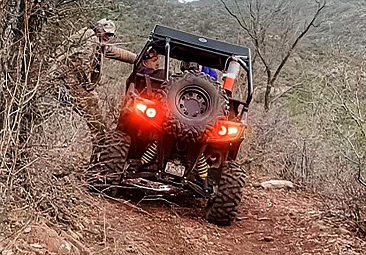 A Jerome police pickup and ATV took three hours to travel the 16 miles of the narrow and unstable sections of Forest Road 413 to reach the couple who overturned their SUV near Jerome. Jason Supple courtesy photo