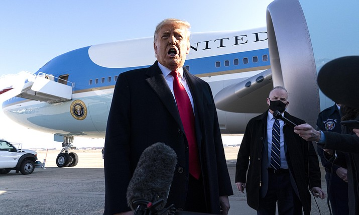 President Donald Trump speaks with reporters as he walks to Air Force One upon departure, Tuesday, Jan. 12, 2021, at Andrews Air Force Base, Md. (AP Photo/Alex Brandon)