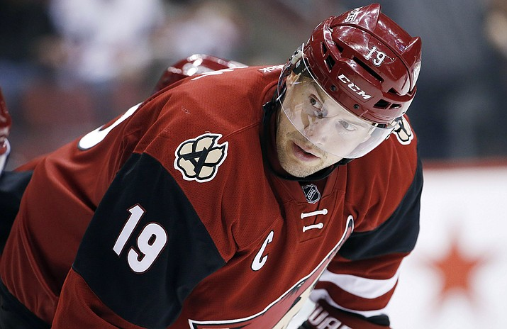 In this Feb. 10, 2016, file photo, Arizona Coyotes' Shane Doan pauses on the ice during the first period of an NHL hockey game against the Vancouver Canucks in Glendale. The Coyotes announced Monday, Jan. 11, 2021, the longtime former captain has been hired as chief hockey development officer for the club. (Ross D. Franklin/AP, file)