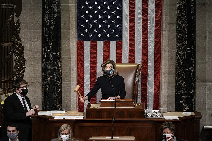 Speaker of the House Nancy Pelosi, D-Calif., leads the final vote of the impeachment of President Donald Trump, for his role in inciting an angry mob to storm the Congress last week, at the Capitol in Washington, Wednesday, Jan. 13, 2021. (J. Scott Applewhite/AP)