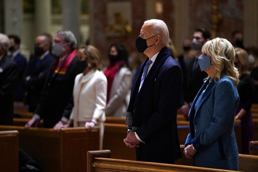 President-elect Joe Biden is joined his wife Jill Biden as they celebrate Mass at the Cathedral of St. Matthew the Apostle during Inauguration Day ceremonies Wednesday, Jan. 20, 2021, in Washington. (AP Photo/Evan Vucci)