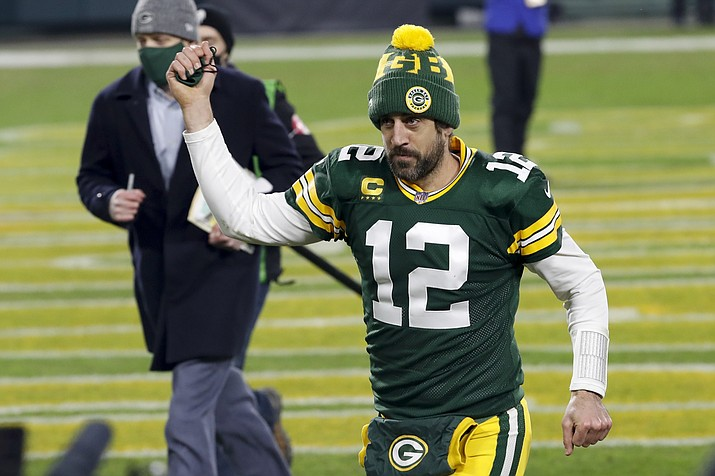 Green Bay Packers quarterback Aaron Rodgers pumps his fist after an NFL divisional playoff football game against the Los Angeles Rams Saturday, Jan. 16, 2021, in Green Bay, Wis. The Packers defeated the Rams 32-18 to advance to the NFC championship game. (Mike Roemer/AP, file)