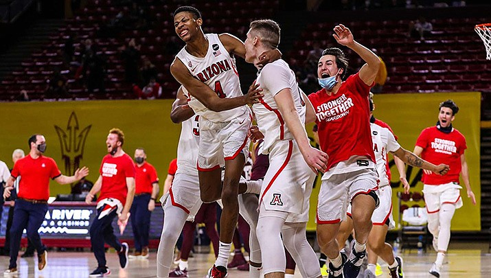 Arizona players celebrate after pulling off an 84-82 win over rival Arizona State in Tempe on Thursday, Jan. 21. (Photo by Mike Christy/Arizona Athletics)