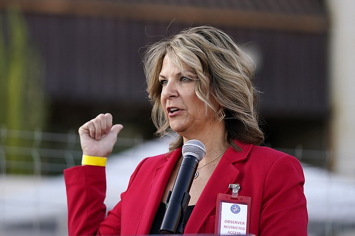 In this Nov. 18, 2020, file photo, Dr. Kelli Ward, chair of the Arizona Republican Party, holds a press conference in Phoenix. The Arizona Republican Party is confronting its future this weekend after losing a second Senate seat and the presidential race. On the agenda for the state committee meeting Saturday: the reelection bid by its controversial chairwoman, who has been among the most prolific promoters of baseless election conspiracies, and the censure of some of the party's best-known figures: Cindy McCain, former Sen. Jeff Flake and Gov. Doug Ducey. (Ross D. Franklin/AP, file)