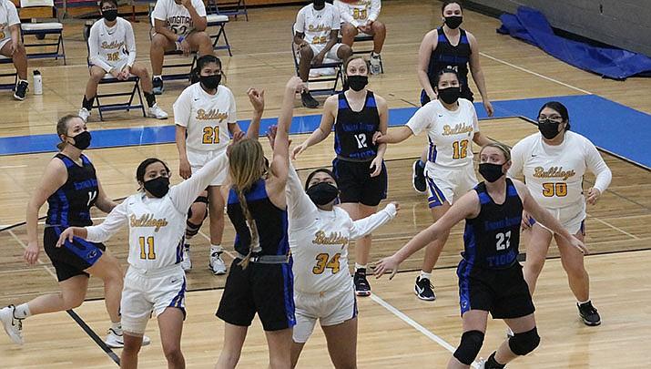 Kingman High School and Kingman Academy players converge in the paint during a girls basketball game on Thursday, Jan. 21. Kingman won 61-39.  (Photo by Travis Rains/Kingman Miner)
