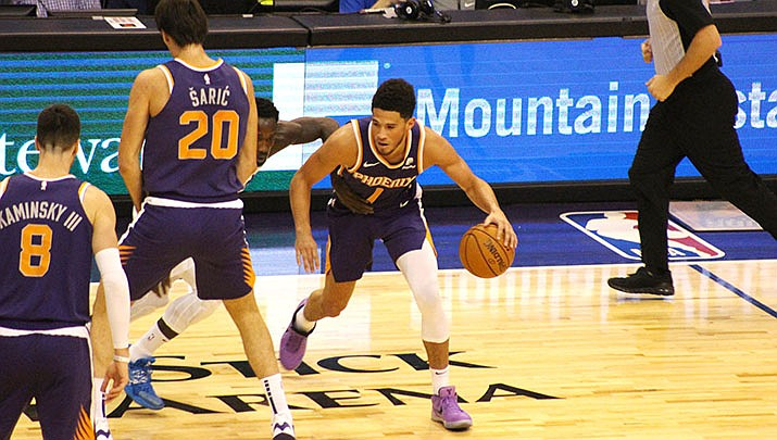 Devon Booker and the Phoenix Suns lost to the Denver Nuggets in overtime on Friday. (Miner file photo)