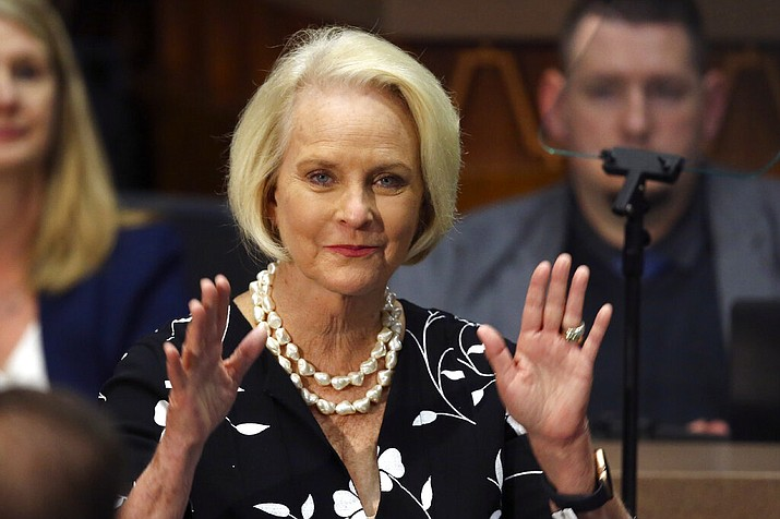 In this Jan. 13, 2020, file photo Cindy McCain, wife of former Arizona Sen. John McCain, waves to the crowd after being acknowledged by Arizona Republican Gov. Doug Ducey during his State of the State address on the opening day of the legislative session at the Capitol in Phoenix. Arizona Republicans voted Saturday, Jan. 23, 2021 to censure Cindy McCain and two prominent GOP officials who have found themselves crosswise with former President Donald Trump. (AP Photo/Ross D. Franklin, File)