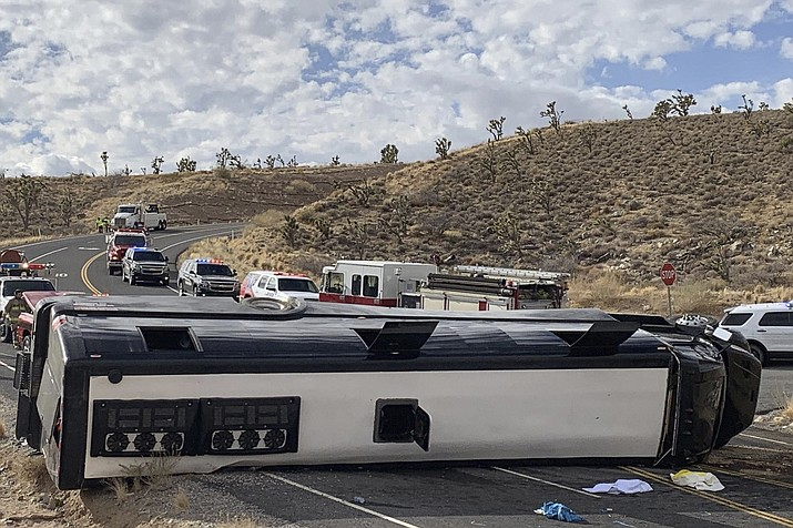 A Las Vegas-based tour bus rolled over in northwestern Arizona Jan. 22. One person died, and two were critically injured. The cause of the rollover is under investigation. (Mohave County Sheriff's Office via AP)
