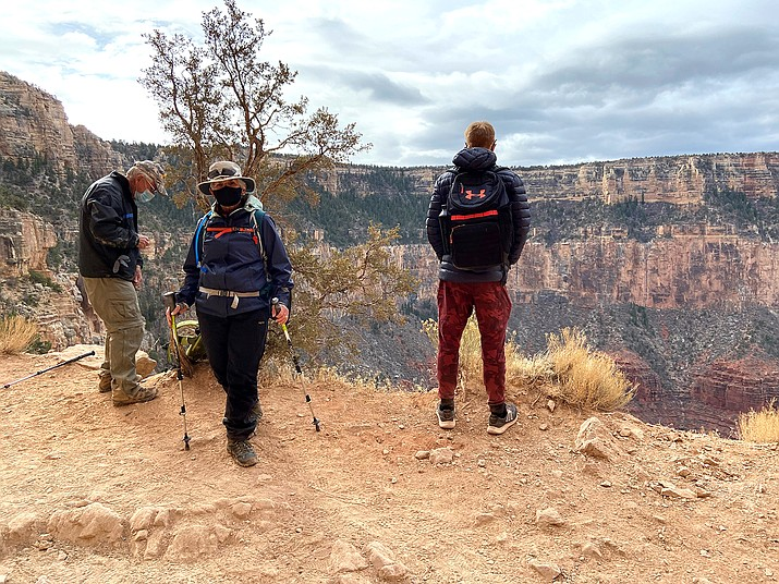 Grand Canyon hikers wear masks on the South Kaibab Trail Dec. 10. Masks are now required on all federal lands.(Wendy Howell/WGCN)