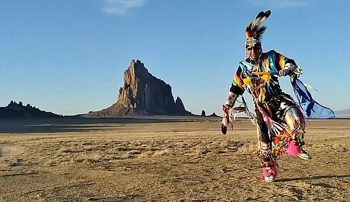 A dancer in front of the iconic Shiprock in New Mexico. (Screenshots from 'Parade Across America')