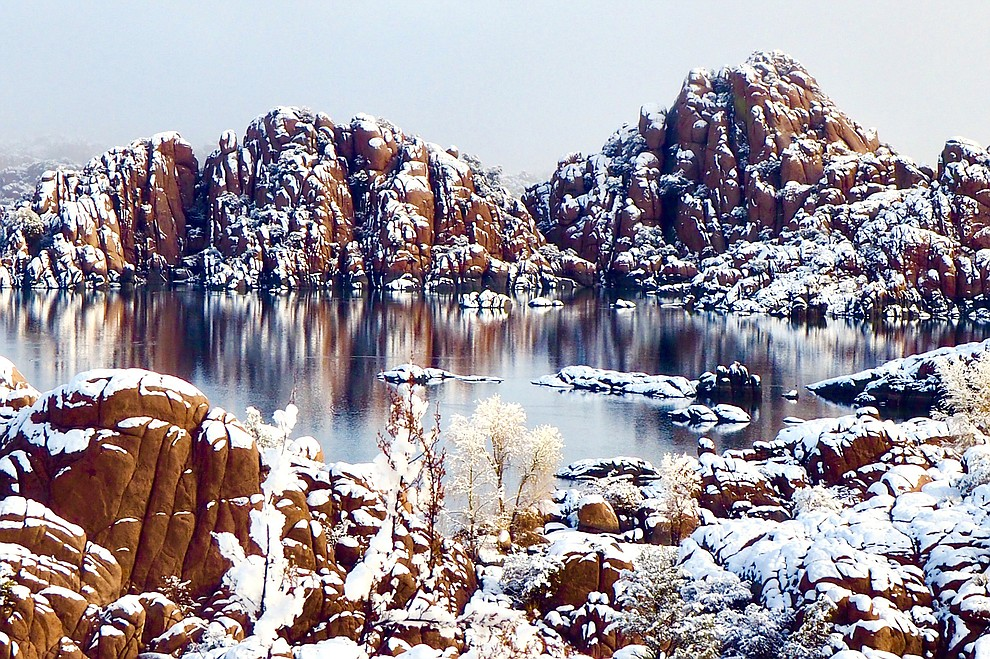 The Dells are reflected in Watson Lake after a January 2021 snowfall in Prescott, Arizona. Photo by Karen Shaw.