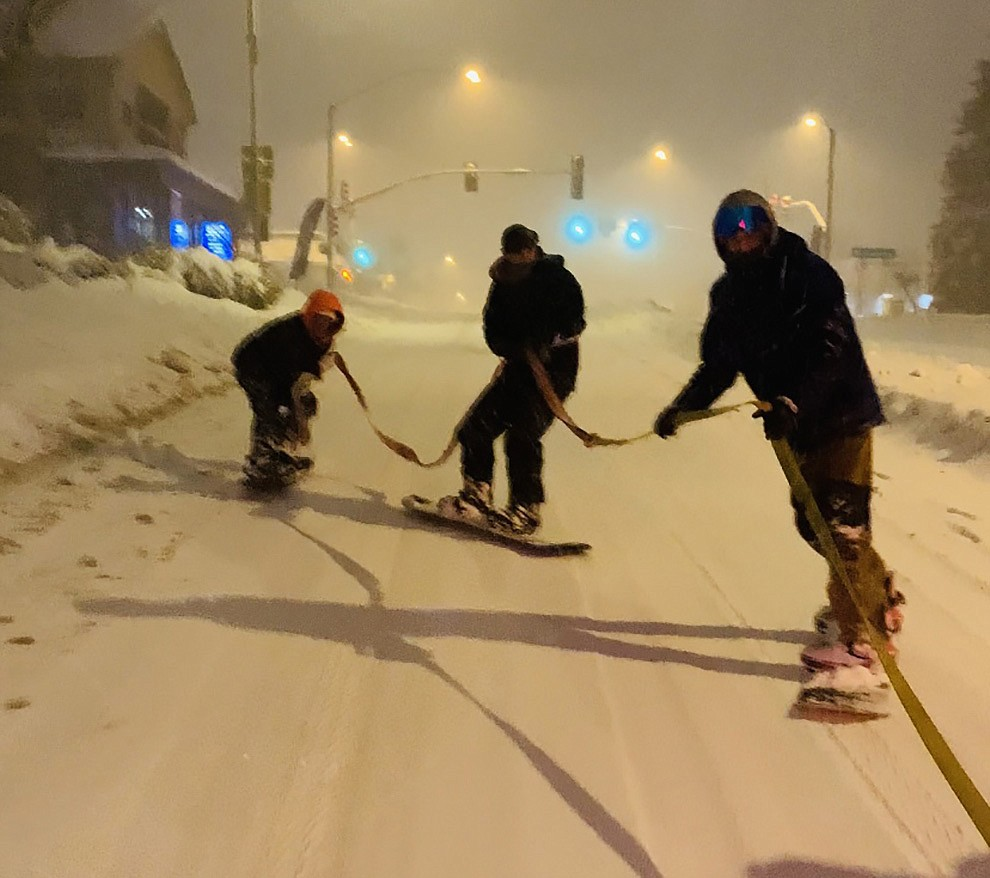 Zane Simmons, Jake Carter, Cody Tucker, Luke McCauslin, and Jackson Arnest snowboarding down whiskey row. Photo submitted by Zane Simmons.