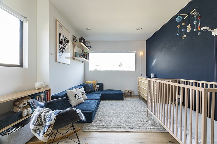This image provided by Fernish shows an outer space inspired child's bedroom. Rachel Magana, senior visual designer at the sustainable furniture-rental company Fernish, says she picked up some cosmological decorating ideas from a colleague's recent nursery project. (Dustin Walker Photography/Fernish via AP)