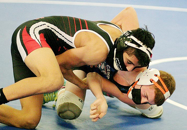 Camp Verde freshman Angel Casillas, bottom, pictured in a recent match, is wrestling with a refined technique, head coach Larry Allred said Friday. VVN/Bill Helm