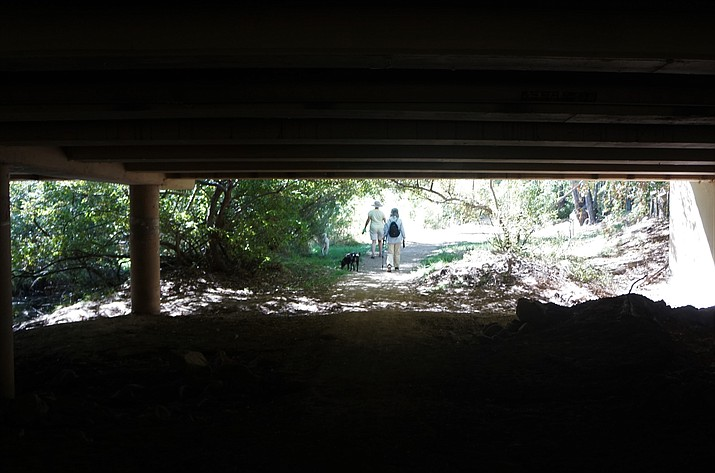 Among the improvements scheduled to begin in the summer of 2021 on the Granite Creek Corridor in downtown Prescott is better lighting along the Greenways Trail. This Courier file photo from October 2020 shows the current dark conditions in the underpasses. (Cindy Barks/Courier file)