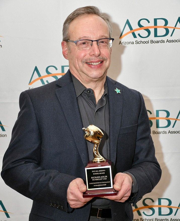 Rich Adler, posing with his 2019 All Arizona School Board excellence award, is the new president of the Humboldt Unified School District board, but he's not new to the board. (Courtesy)