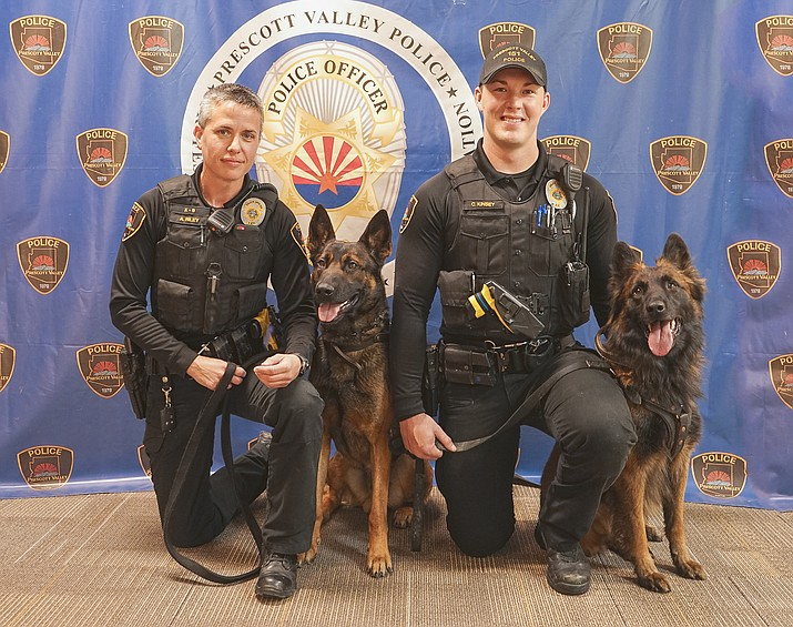 Pictured are Prescott Valley Police Officer Amanda Riley, left, with K9 Kion. At right is Officer Cameron Kinsey with K9 Chewey. (Prescott Valley Police Department/Courtesy)