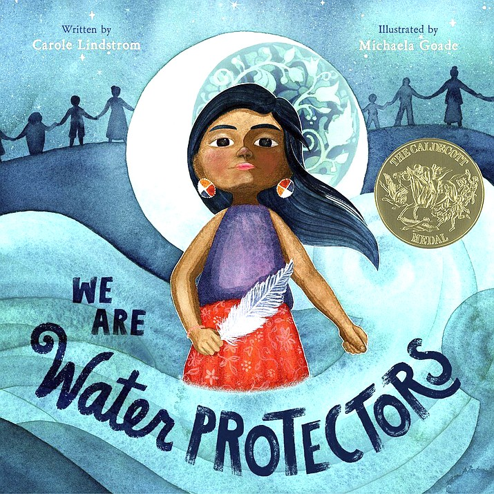 """""""We Are Water Protectors,"""" written by Carol Lindstrom and illustrated by Michaela Goade recently won the prestigious Randolph Caldecott Medal for best children's picture story. (Roaring Brook Press via AP)"""