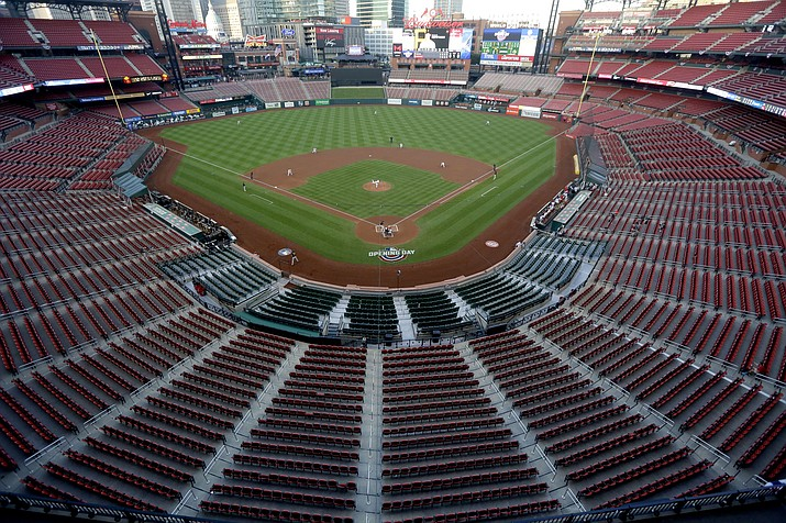 In this July 24, 2020, file photo, empty seats are viewed in Busch Stadium as St. Louis Cardinals starting pitcher Jack Flaherty throws in the first inning baseball game against the Pittsburgh Pirates in St. Louis. Major League Baseball players rejected a proposal to delay the start of spring training and the season due to the coronavirus pandemic, vowing Monday, Feb. 1, 2021, to report under the original schedule. (Jeff Roberson/AP, file)