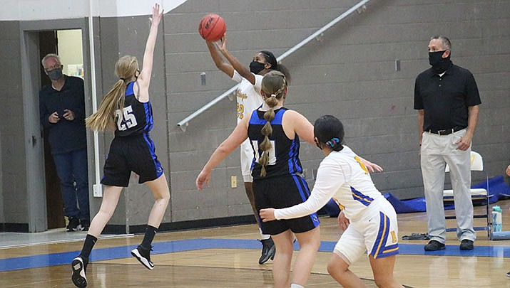 Harmony Brown of the Kingman High School girls basketball team takes a shot during an early-season game against Kingman Academy. The Bulldogs beat Wickenburg 55-43 on Tuesday, Feb. 2. (Miner file photo)