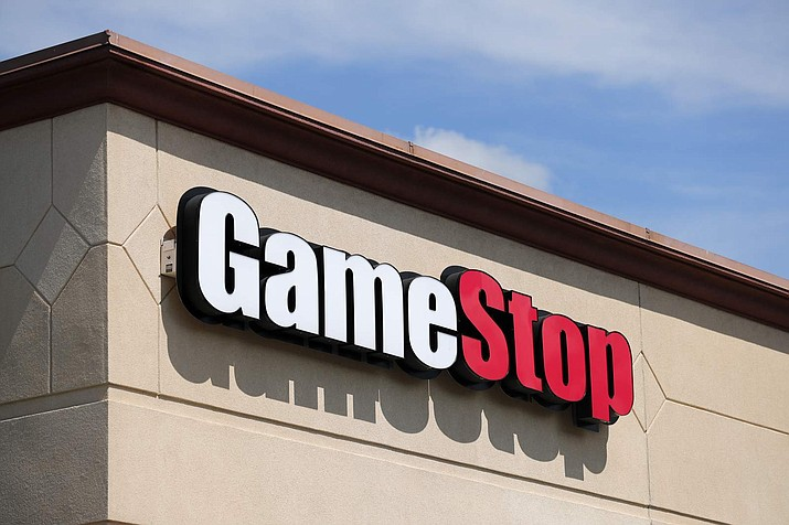 This file photo shows a GameStop store in St. Louis. With GameStop's share price skyrocketing last month behind a speculative frenzy driven by a Reddit chat group, a 10-year-old San Antonio boy sold his shares originally valued at $60 for about $3,200. (AP Photo/Jeff Roberson, File)