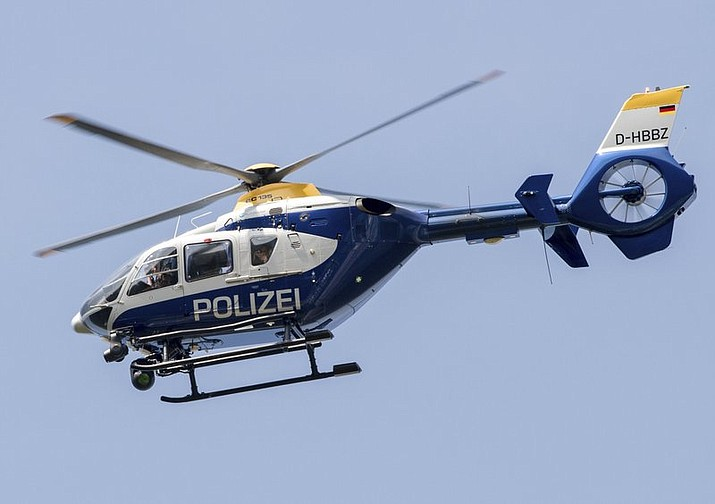 This file photo shows a police helicopter flying over the A12 motorway near Briesen, Germany. Police say a 32-year-old Berlin man has been arrested on allegations he had been making radio contact with air traffic, including police helicopters, and given fake flight orders while impersonating an aviation official. (Patrick Pleul/dpa via AP)