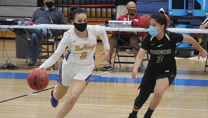 Amber Lopez breaks Youngker's pressure defense on Wednesday, Feb. 3. The Kingman High School sophomore scored 11 points. (Photo by Casey Jones/Kingman Miner)