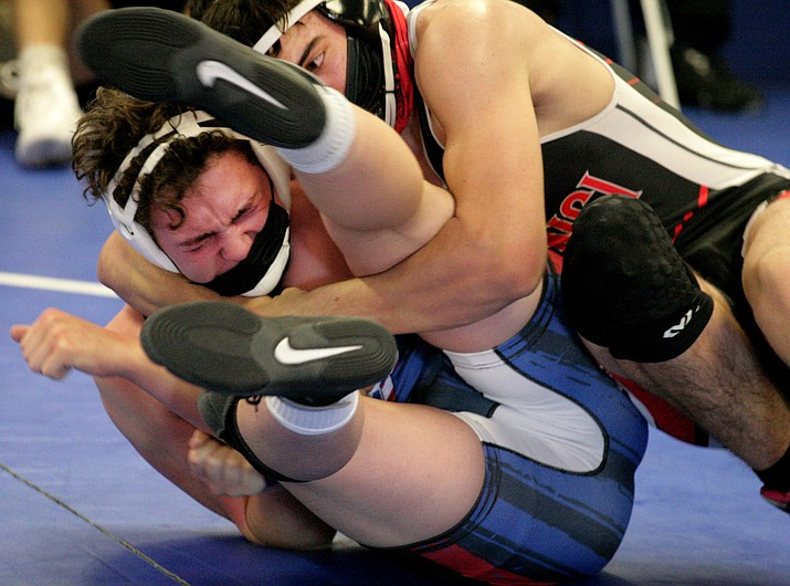 Camp Verde 138-pound wrestler Jeremy Jones, left, pictured earlier this year, has pinned his last four opponents. VVN/Bill Helm